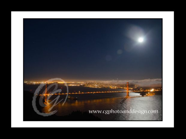 golden gate bridge under full moon with fog over city