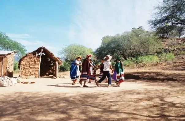 Guaraní children dancing in circle
