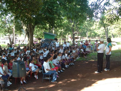 Denis and Alvira in front of a typical crowd.