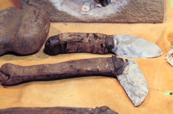 Stone knife blades tied to bone handles used to cut meat and natural fibers