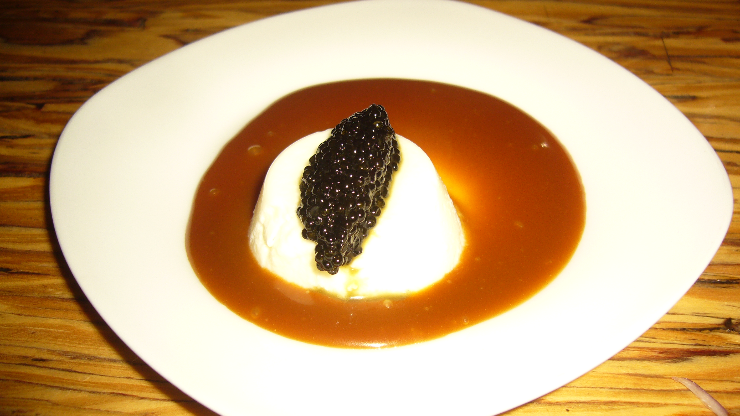Creme Fraiche Panna Cotta with Caramel and Caviar is perfectly executed contrast in flavors; the soft, creamy panna cotta is enveloped by the sweet, smooth caramel and then taken to an entirely new level by the salty, burst in your mouth caviar.