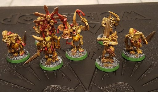 "A completed unit of Plague Bearers, via the ""dip"" method."