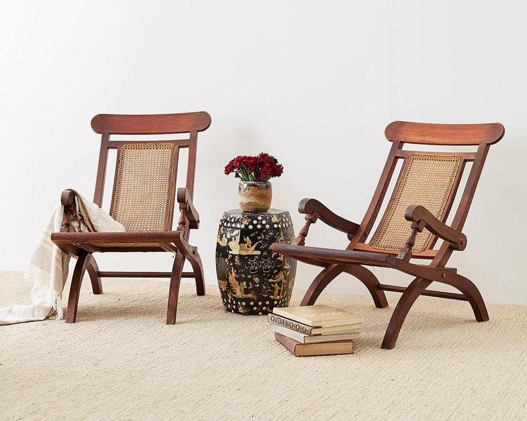 plantation style chairs small table and for kitchen uk pair of mahogany campaign folding chairish unique cane armchairs or made in the