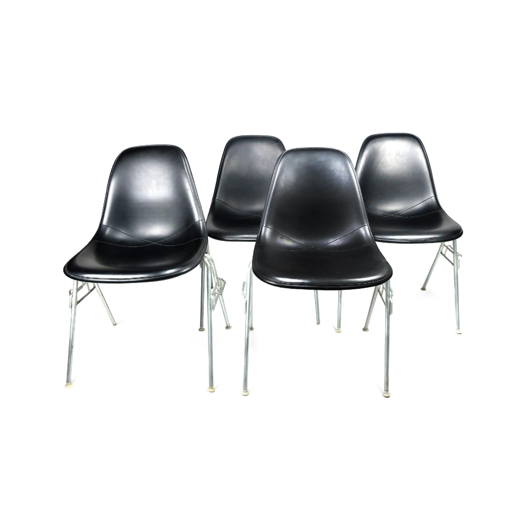 upholstered stacking chairs flip chair bed black eames for herman miller set of plastic four sale