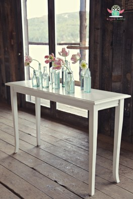 Skinny white vintage table at The Barn in Evergreen, Photographed by Megan Verdre