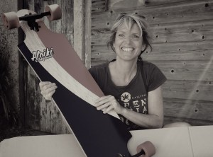 smiling lady with skateboard