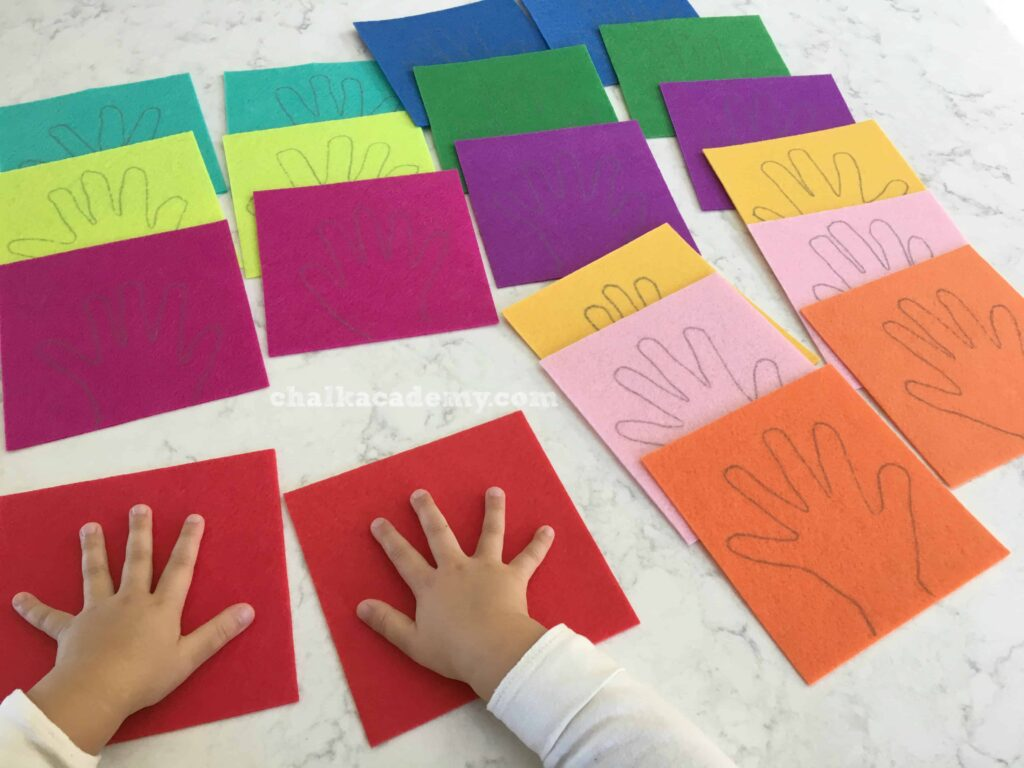 Getting ready to trace both hands on colorful felt! Red, Orange, Yellow, Green, Blue, Purple, Pink
