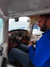 Biggles takes the controls at his flying lesson.
