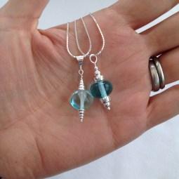 Blue lampwork pendants.