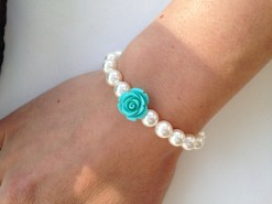 Pretty flower bracelet.Pretty white pearl bracelet with turquoise resin flower, perfect for a flower girl gift. Also available in different colours.