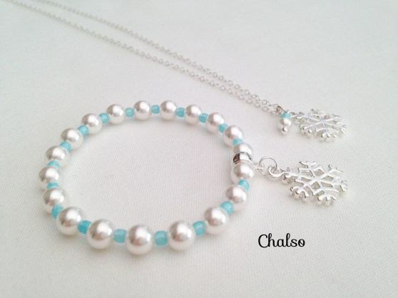 Snowflake necklace and bracelet set with white Swarovski pearls, light blue seed beads and shiny snowflake charms.