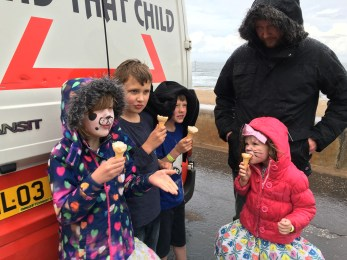 Summer in Scotland, eating ice cream sheltering from the wind and rain behind the ice cream van on Portobello promenade in the summer holidays!