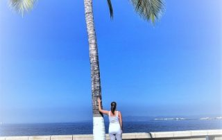 Eileen Callahan Luxury Travel Expert of Champagne Travels at the beach in Puerto Vallarta