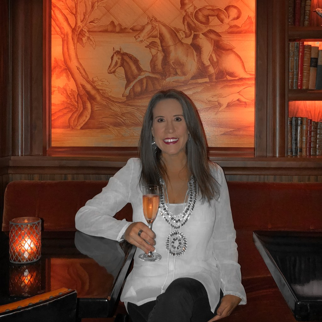 Eileen Callahan Luxury Travel Expert of Champagne Travels drinking Champagne in Dallas Texas