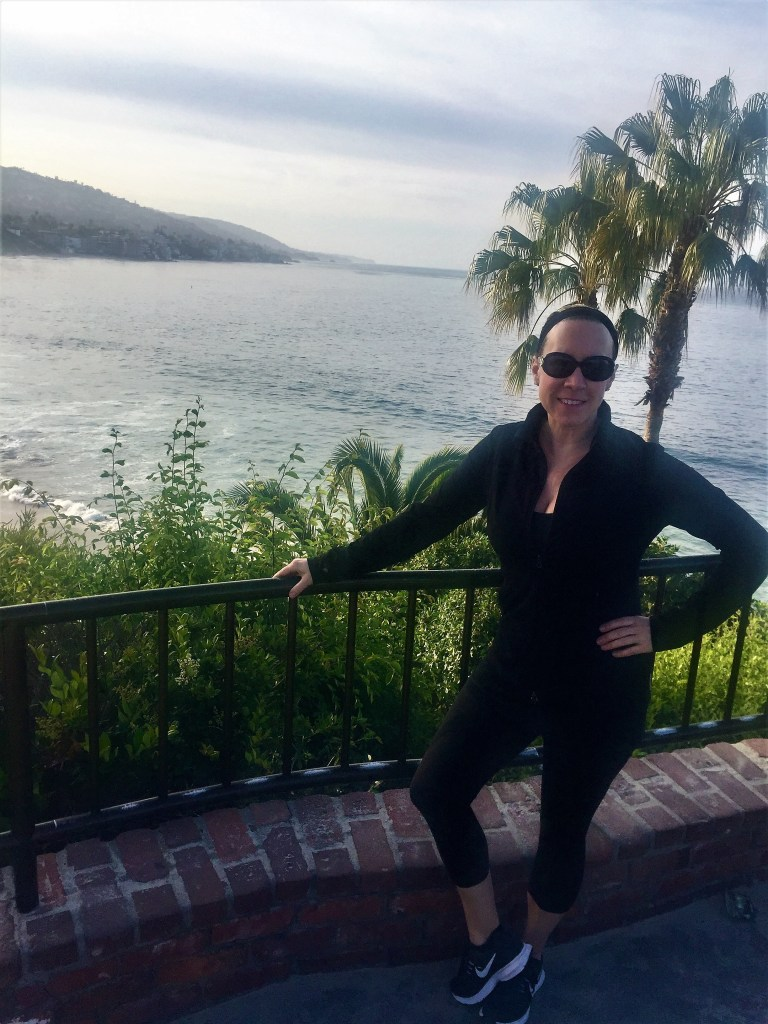 Eileen Callahan Champagne Travels Luxury Travel Expert working out in Laguna Beach Califorina