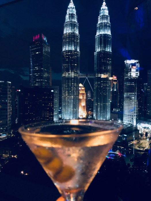Eileen Callahan luxury travel writer for champagne travels enjoying a Grey Goose Martini in Kuala Lumpur
