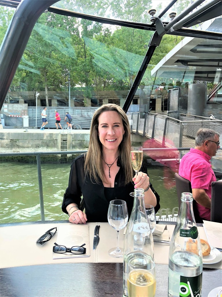 Champagne Travels luxury travel website Eileen Callahan enjoys a boat cruise in Paris France