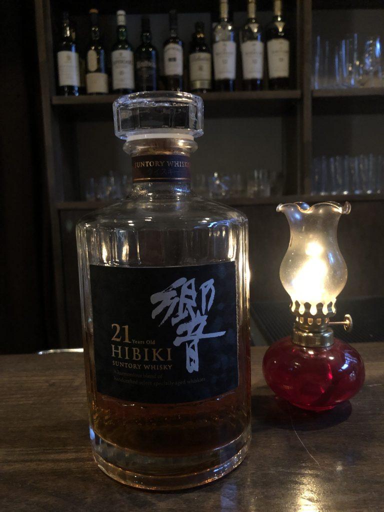Eileen Callahan of Champagne Travels drinking Hibiki 21 year Suntory Whiskey