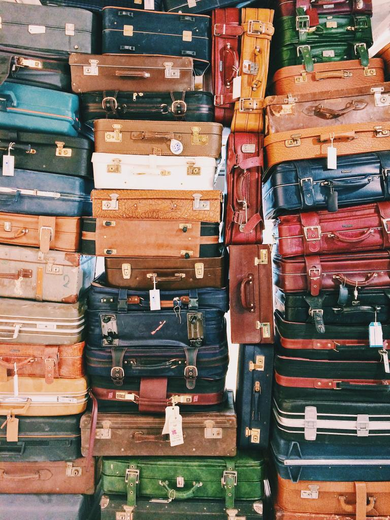 Luggage stacked in variety of colors