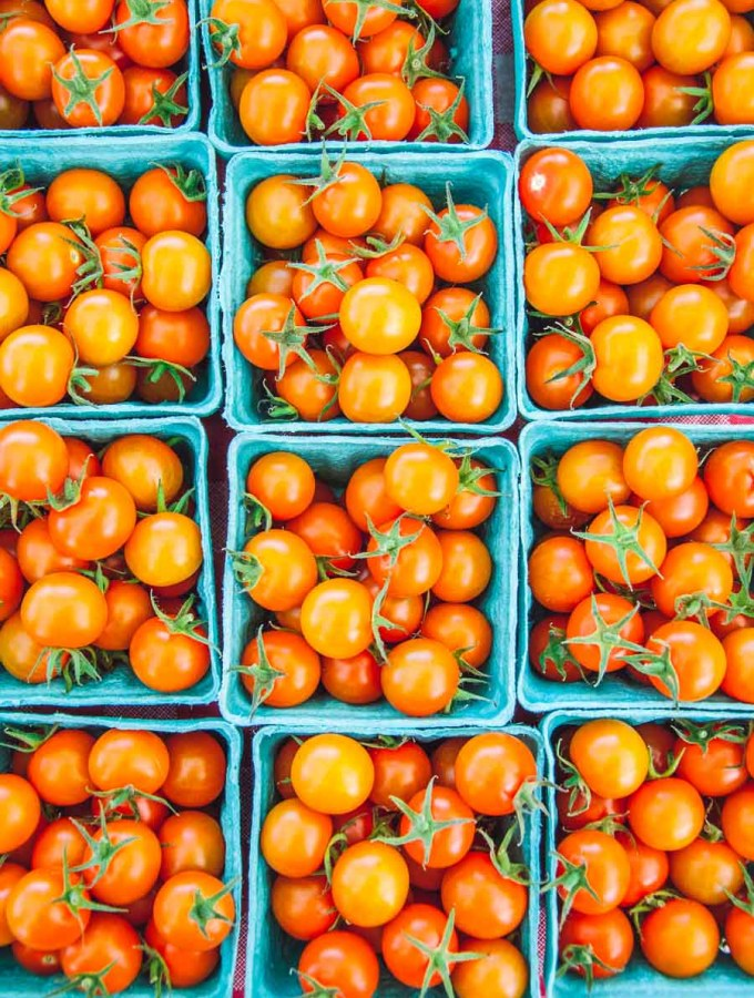 orange cherry tomatoes in baskets