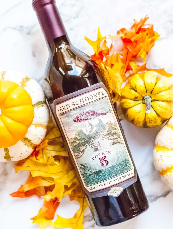 Bottle of Red Schooner with leaves and pumpkins on a table