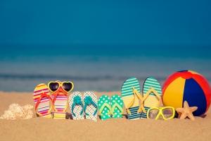 colourful thongs on a beach