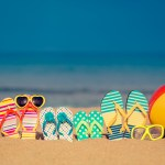 colourful thongs on a beach