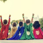 boys and girls dressed as superheroes