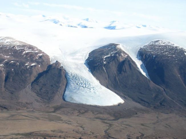 Teardrop Glacier, Sverdrup Pass, central Ellesmere Island, Nunavut. Note: Little Ice Age trimline ~ 200 m beyond the ice margin. Measured ice retreat has rapidly accelerated since 2004 exposing pristine LIA plant communities composed of bryophytes and vascular plants From: Arctic Workshop 2013 Abstract