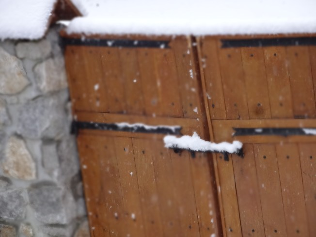 Snowy garden gate, seen from the warmth of the house. Photo: PK Read