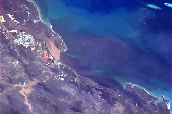 The flooding and flow of sediment into the Coral Sea at Gladstone, Australia, blamed by many on dredging. Dredging at Gladstone Harbour is under investigation for causing mass marine life death. Image: Cmd. Chris Hadfield  via Twitter