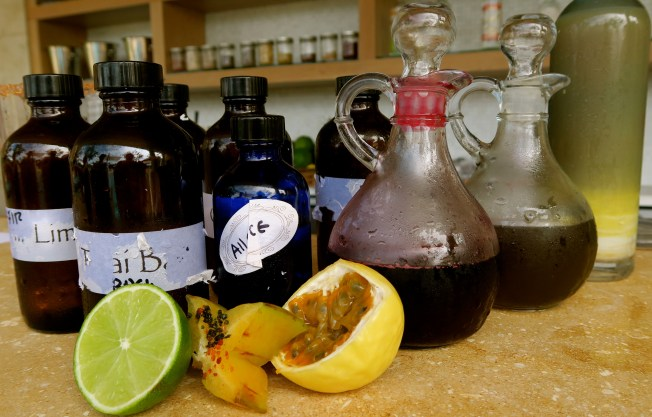 The well-used hydrosols - basil, lime, allspice, etc., with the simple syrup bottles and a few of the fruits used.
