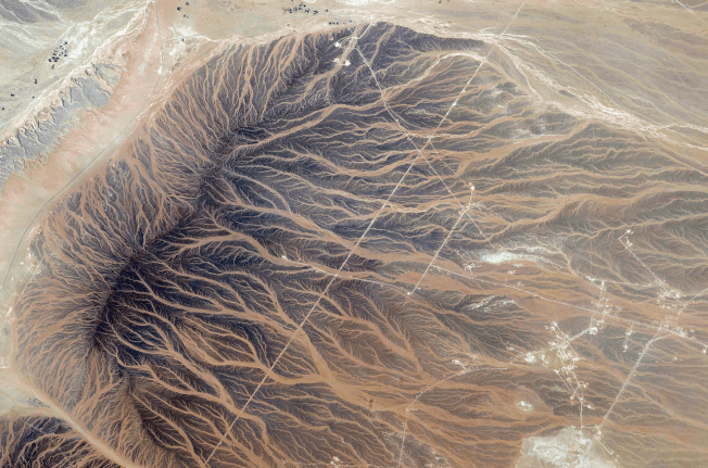 """The delicate fingerprints of water imprinted on the sand. The #StoryOfWater.""  Image: Kjell Lindgren/NASA via Instagram"