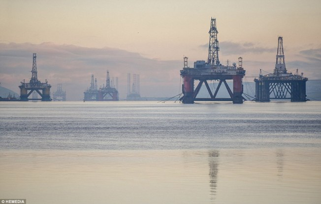 The Cromarty Firth, north of Inverness, is currently packed with more unused rigs than it has been at any point in the last decade Read more: http://www.dailymail.co.uk/news/article-3410415/The-oil-rig-graveyard-dozen-thousand-tonne-structures-parked-unused-Scottish-firth-market-swamped-cheap-crude-demand-drilling-drops.html#ixzz4GrmKAQVN Follow us: @MailOnline on Twitter | DailyMail on Facebook