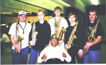 Clark and the saxophone section.