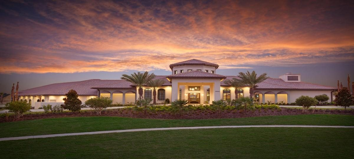 The oasis clubhouse at championsgate at sunset