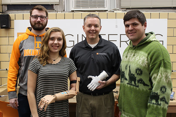 Makers club president Chase Cumbelich, Riley Toll, Chad Duty and Alex Weber show some of the 3D printed limbs that the club has made