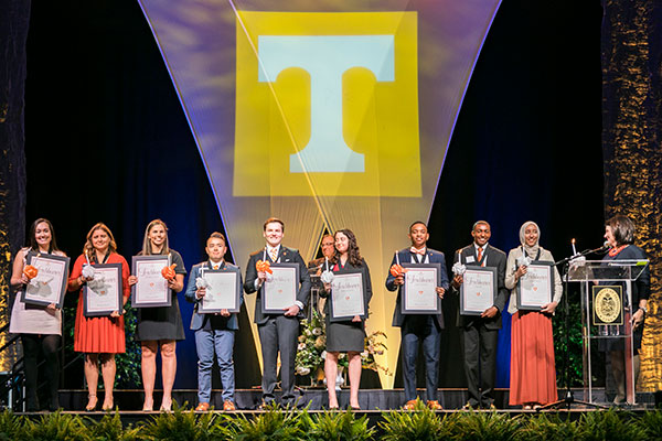 Outstanding students are recognized as Torchbearers during the Chancellor's Honor Banquet