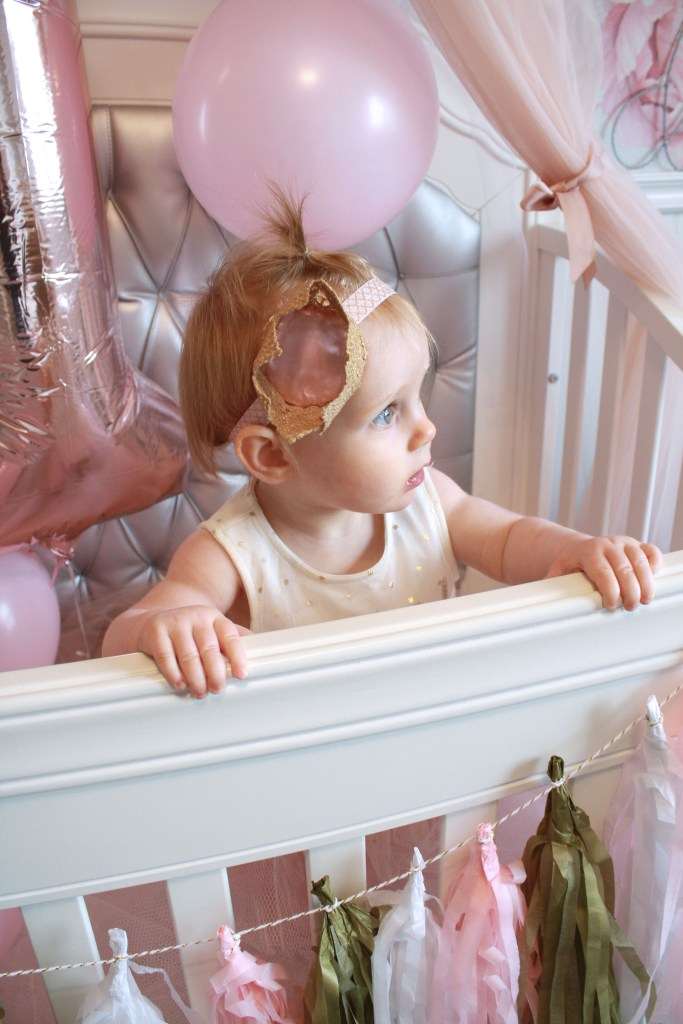 Easy first birthday ideas: Birthday princess enjoys her crib decorated for her first birthday