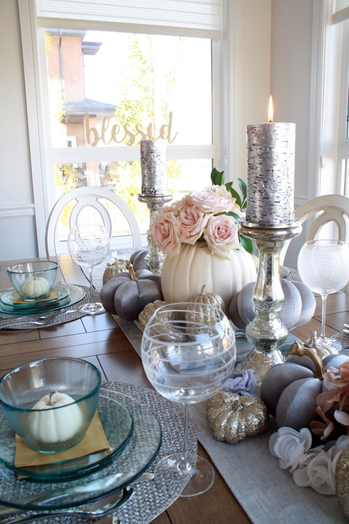 Closeup on grey and pink fall table setting