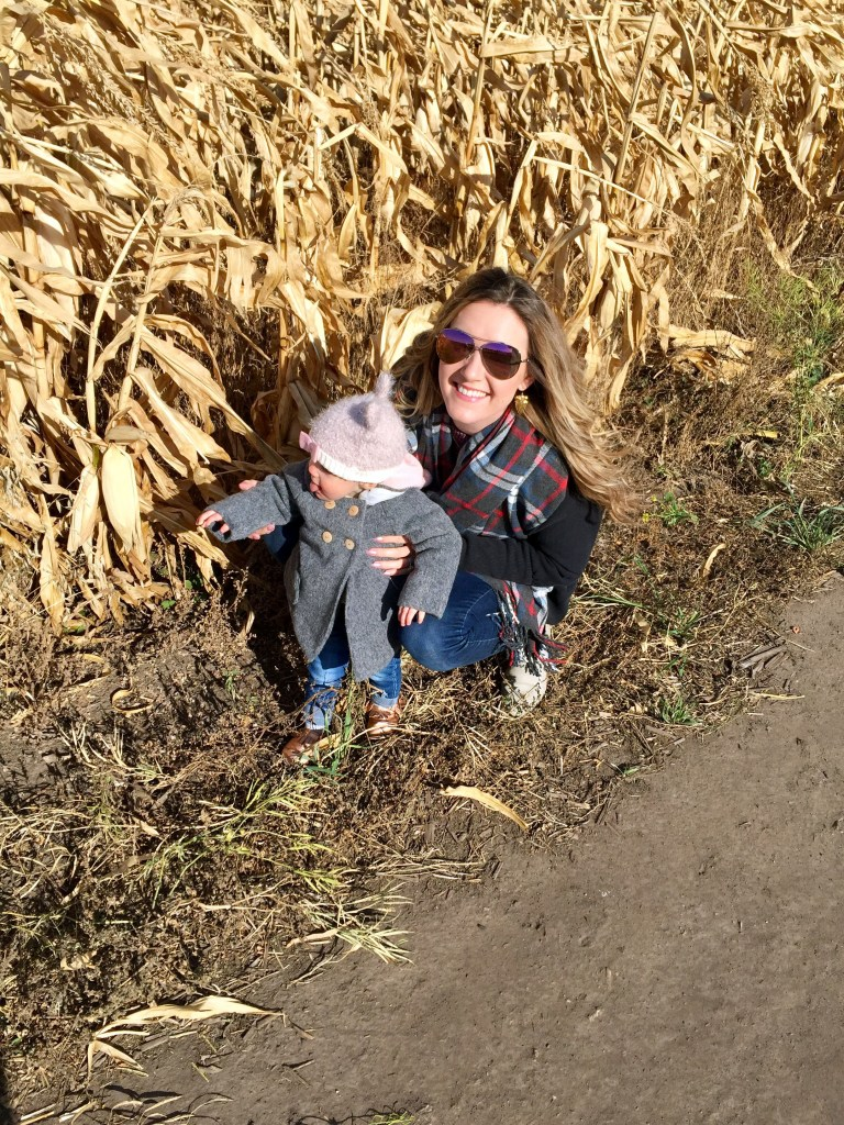Mom and baby enjoy corn field