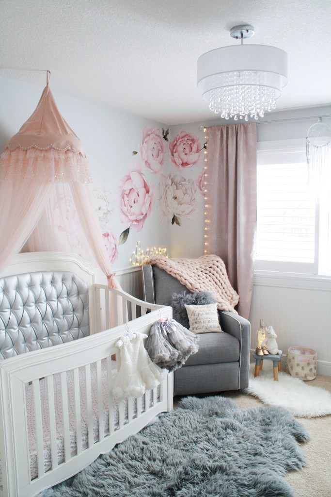 Baby girl pink and gray nursery with chandelier, tufted crib, pink crib canopy and peony wall decals