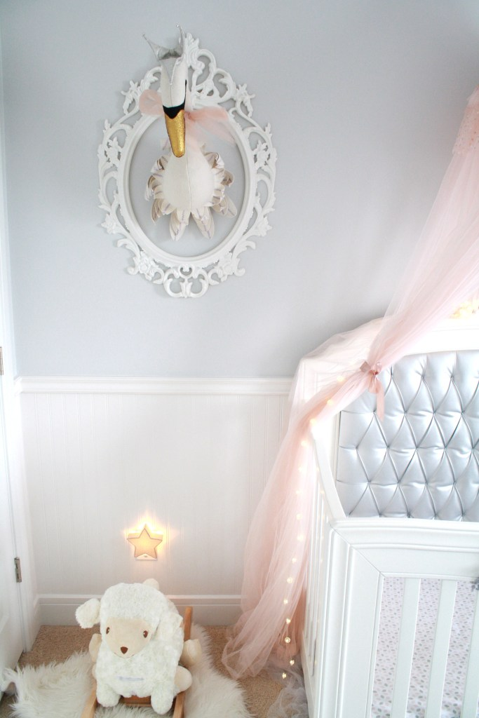 Pink and gray nursery with swan head taxidermy