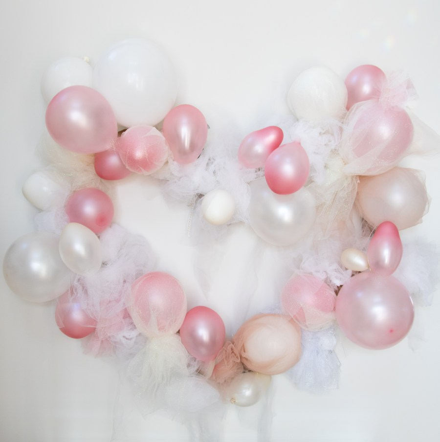 Gigantic tulle heart balloon wreath perfect for Valentine's day, baby showers, bachelorette parties and more on Chandeliers and Champagne
