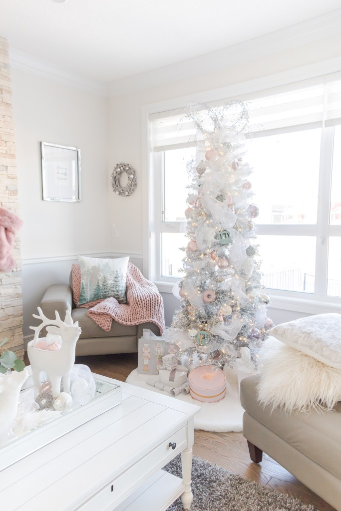 pretty pastel christmas decor with pink stockings pink christmas tablescape white ombre christmas tree