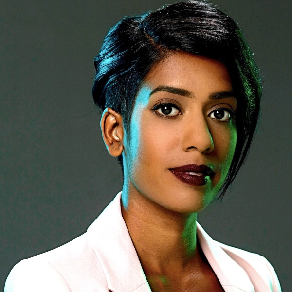Sheree Atcheson, a Sri Lankan woman with short black hair and white jacket