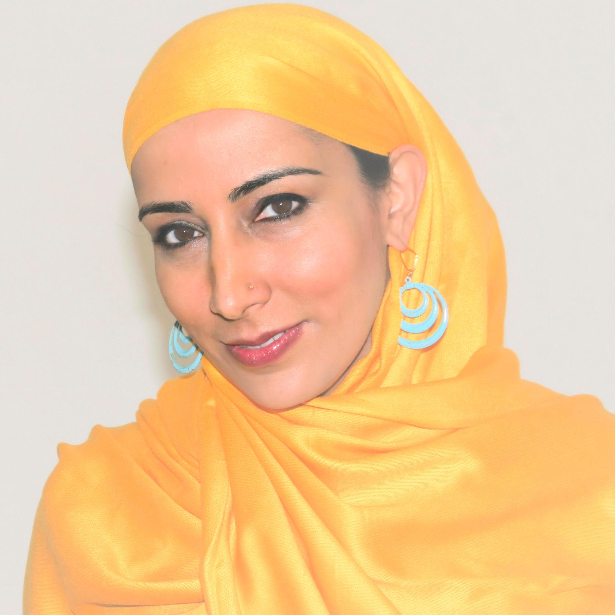 Najeeba Syeed, a South Asian Muslim American woman wearing a yellow headscarf