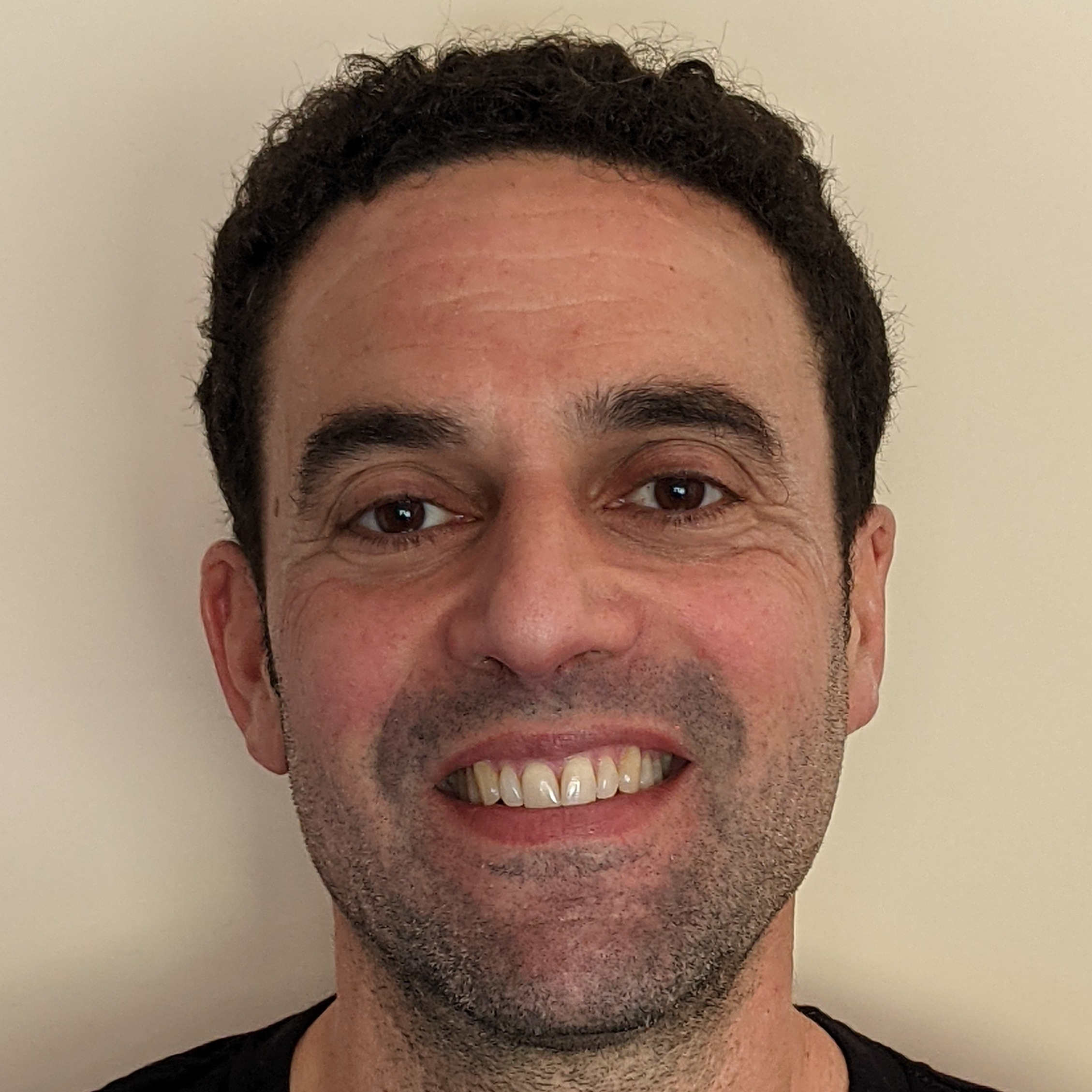Jeremy Sussman, a White man with short black hair and a black shirt.