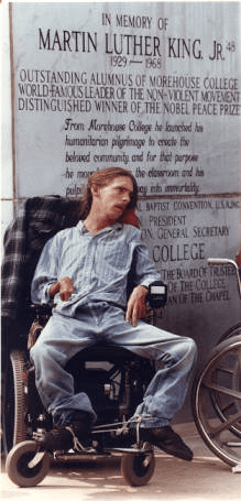 ADAPT Rally 1990, young man in wheel chair in front of MLK monument