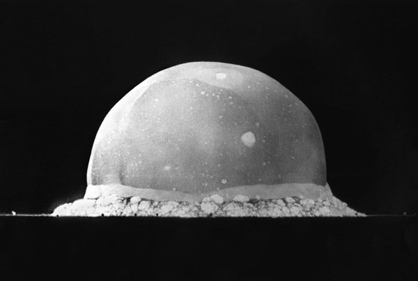 black and white photo of the trinity atom bomb 16 milliseconds after trigger